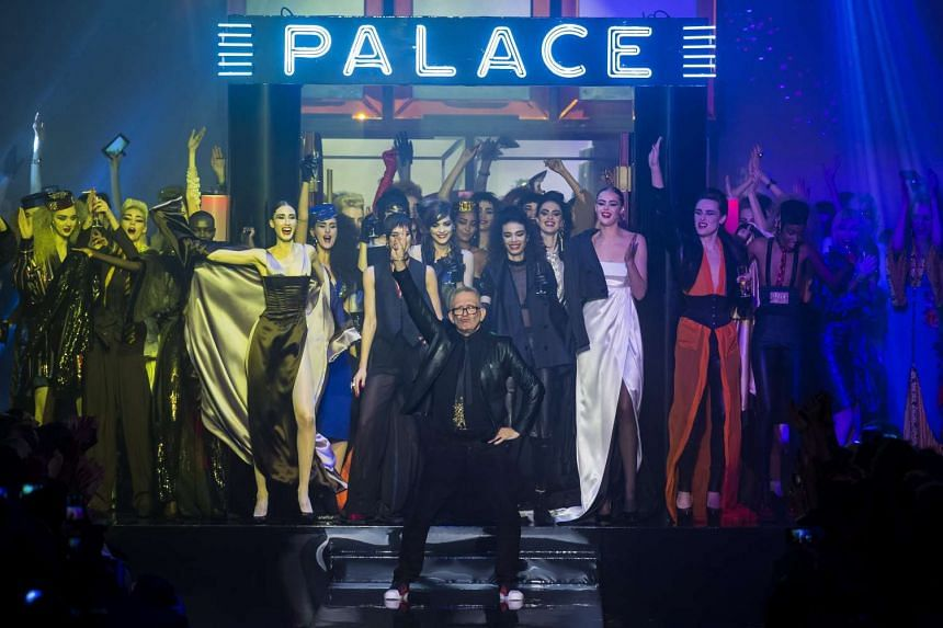 French designer Jean Paul Gaultier (centre) celebrates after presenting his Spring/Summer 2016 Haute Couture collection during the Paris Fashion Week yesterday.