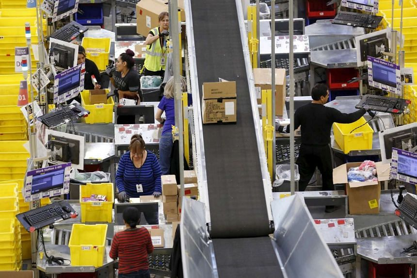 Workers prepare orders for customers at the Amazon Fulfillment Center in California.