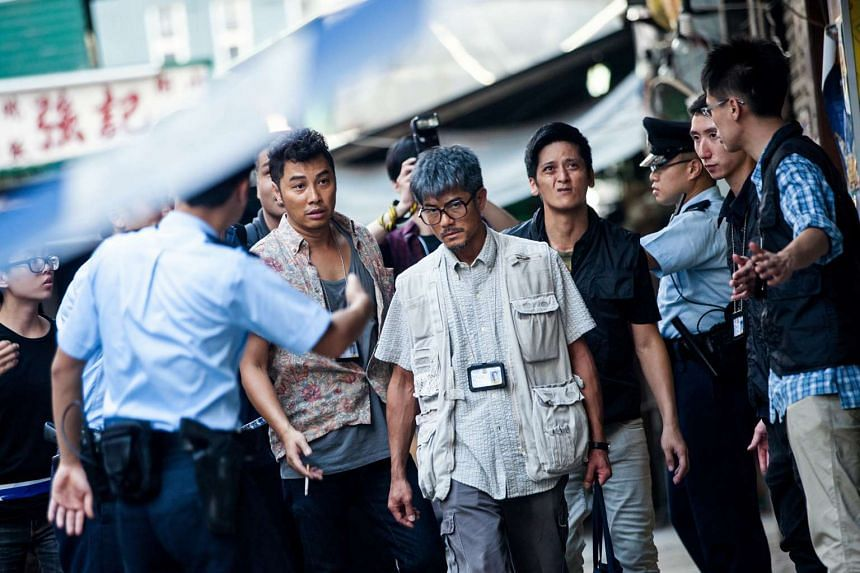 Cinema still: Port Of Call starring Aaron Kwok (centre).