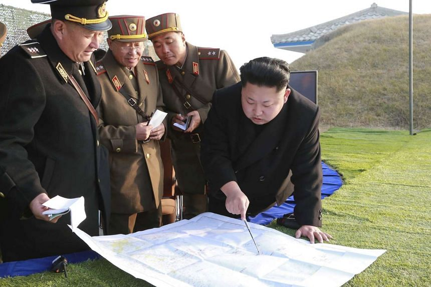 North Korean leader Kim Jong Un organising and guiding a combined joint drill of the units under KPA Combined Units 572 and 630 on Nov 23, 2014.