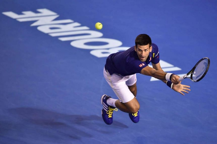 Novak Djokovic hits a return during his match against Roger Federer on Jan 28, 2016.