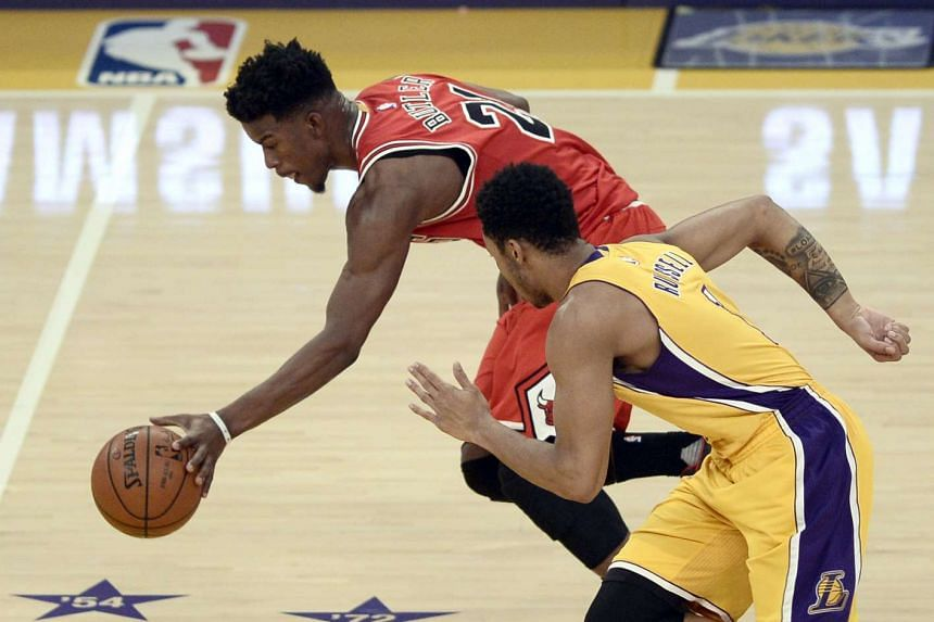 Chicago Bulls' Jimmy Butler (left) stealing the ball from Los Angeles Lakers' D'Angelo Russell on Jan 28, 2016.