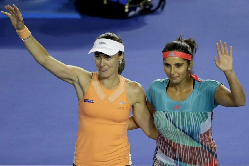 Martina Hingis (left) and Sania Mirza during their match against Lucie Hradecka and Andrea Hlavackova on Jan 29, 2016.