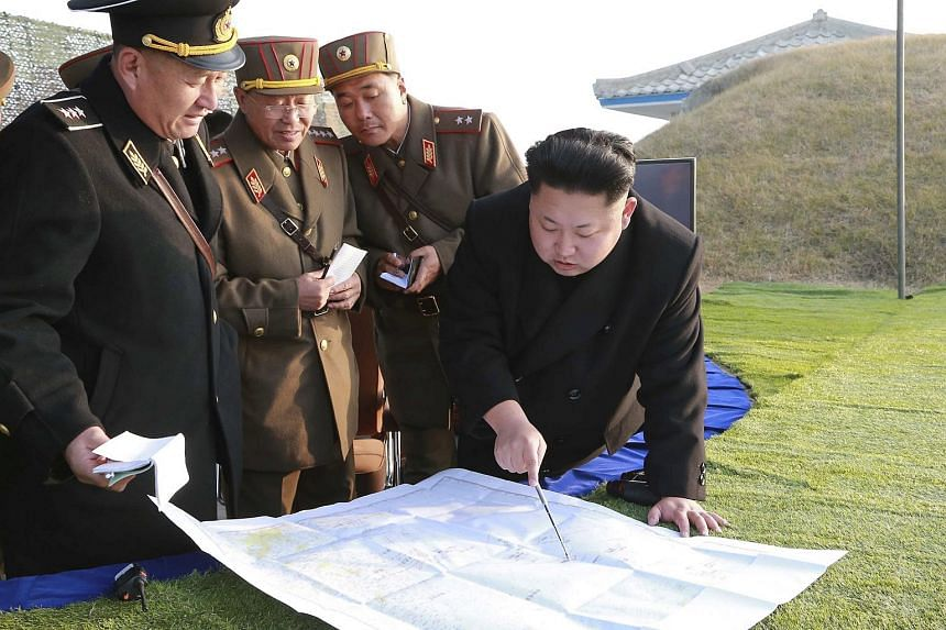 North Korean leader Kim Jong Un (right) organising a military drill in this undated photo released by the Korean Central News Agency on Nov 23, 2014.