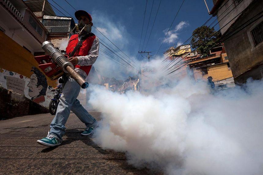 Health workers fumigating to stop mosquito breeding in Caracas, Venezuela, on Jan 28.