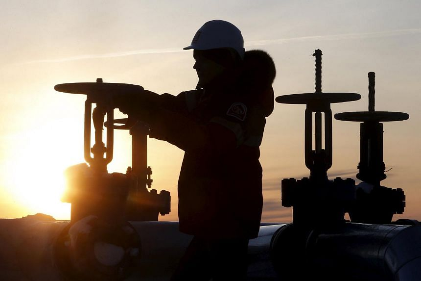 A worker checking a pipe at an oil field outside the West Siberian city of Kogalym, Russia, on Jan 25.