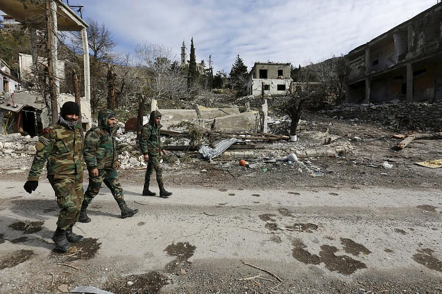 Forces loyal to Syria's President Bashar al-Assad in the town of Rabiya after recapturing it from rebels, on Jan 27.