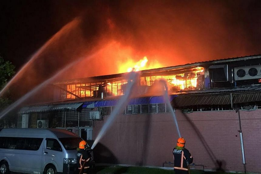 Firefighters using water jets to contain the fire at Toa Payoh Industrial Park on Jan 29, 2016.