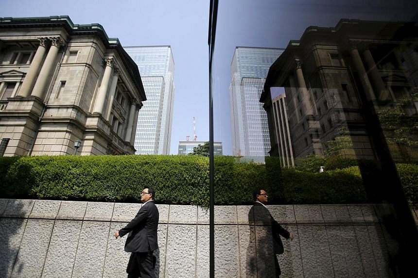 A pedestrian walking past the Bank of Japan building in Tokyo.