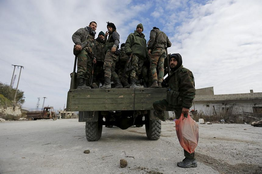 Forces loyal to Syria's President Bashar al-Assad standing on a military truck in the town of Rabiya on Jan 27.