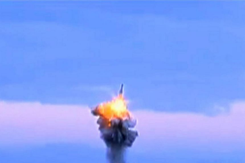 An image taken from television footage released late on Jan 8, 2016, from North Korea's KCTV via AFPTV shows a missile being launched from underwater, from off the coast of North Korea, purportedly on Dec 21, 2015.