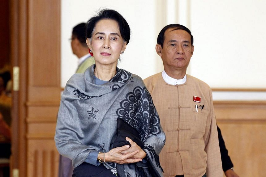 Myanmar democracy leader Aung San Suu Kyi (centre) leaving parliament building in Naypyitaw on Jan 28.