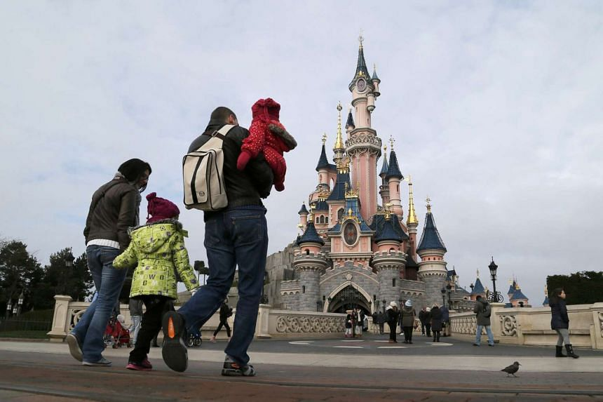 Visitors walk towards the Sleeping Beauty Castle during a visit to the Disneyland Paris in this file photo.