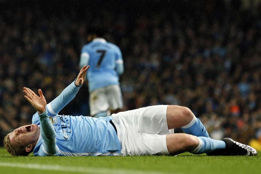 De Bruyne reacts after sustaining an injury.