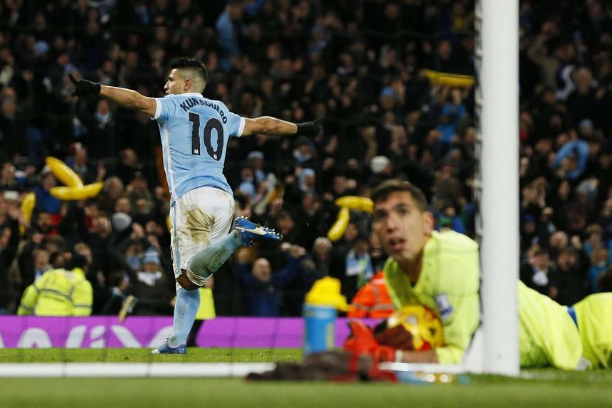 Sergio Aguero celebrating after scoring the third goal for Manchester City as Everton goalkeeper Joel Robles watches on. City won 3-1 and 4-3 on aggregate.