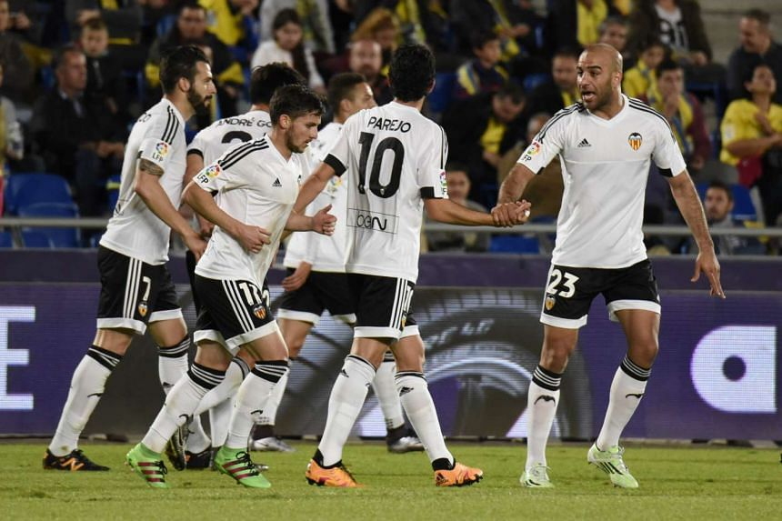 Valencia players celebrate after scoring.