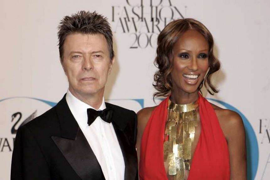 Singer David Bowie arrives with wife Iman at the 2007 CFDA Fashion Awards in New York on June 4, 2007.