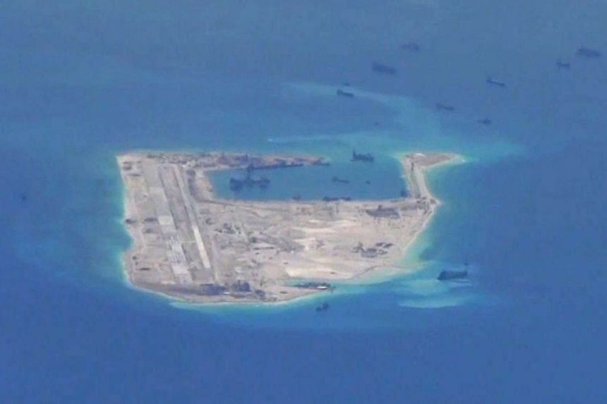 China's foreign ministry said that a US warship violated Chinese law by entering its territorial waters near Paracel Islands.