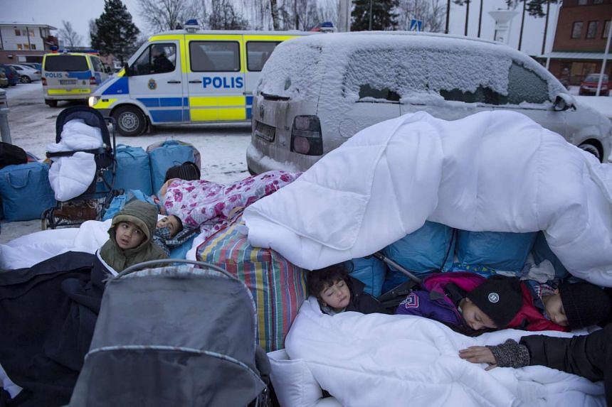 Migrant children sleep at the Swedish Migration Board outside Stockholm, Sweden.