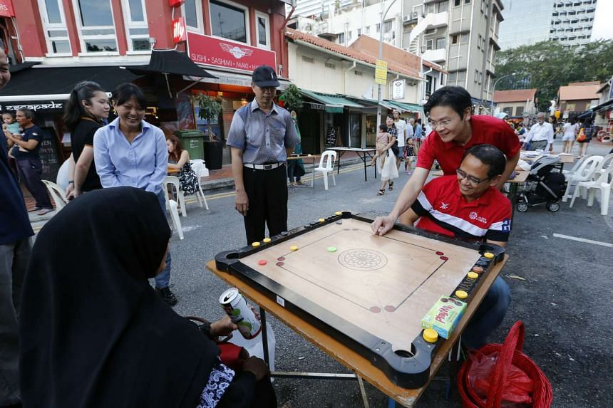 Mr Lawrence Wong (second from right) visiting car-free zones at Kampong Glam and Liang Seah Street on Jan 30, 2016.