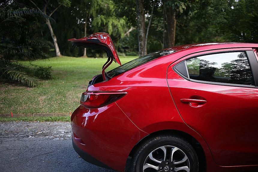 The roof of the Mazda 2 Sedan slopes all the way back to meet the boot.