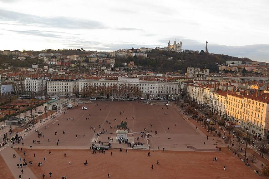 The giant Ferris wheel (far left) looks over the Place Bellecour in Lyon (left). The trip in the Ford S-Max started and ended in Paris.