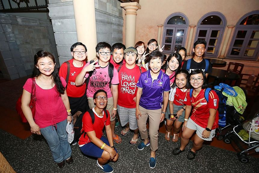 Minister for Culture, Community and Youth Grace Fu (in purple polo shirt) with volunteers of last month's Asean Para Games at an appreciation event held at Universal Studios Singapore last night. An estimated 3,500 volunteers were treated to a specta