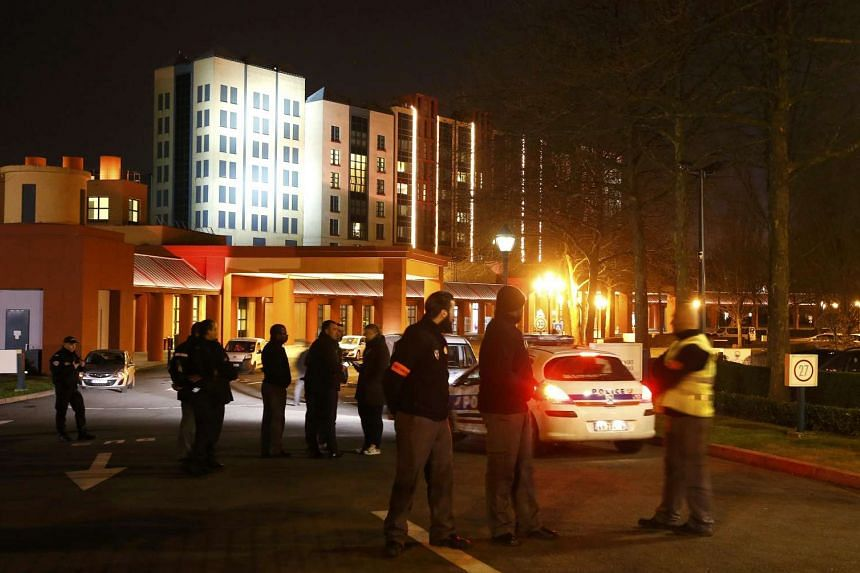 French police and security staff secure the area next to the New York hotel near the Disneyland Paris Resort.
