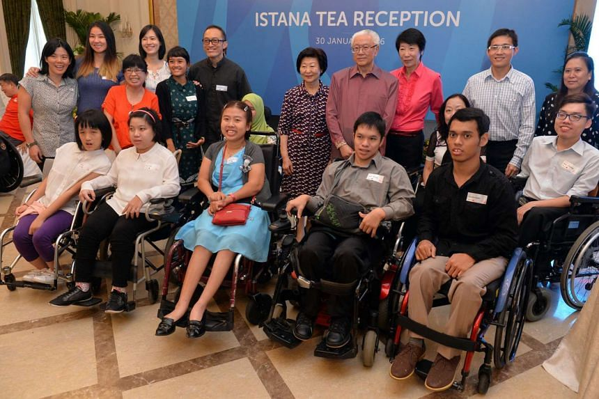 President Tony Tan (back, fourth from right) with the Singapore Para games Boccia team members.