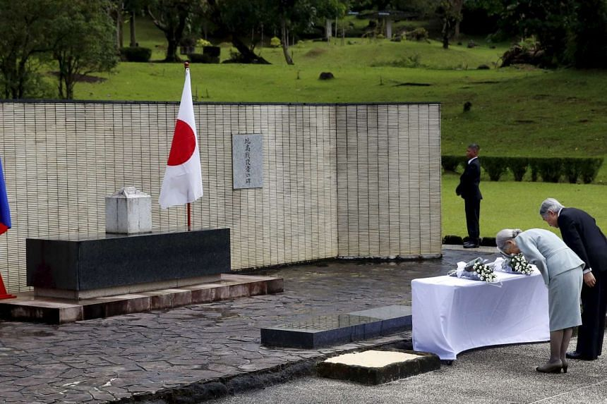 Emperor Akihito and Empress Michiko paying their respects to Japanese soldiers killed during Japan's World War II occupation of the Philippines. Their visit comes as Tokyo and Manila strengthen ties, partly to counter Beijing's increasingly assertive
