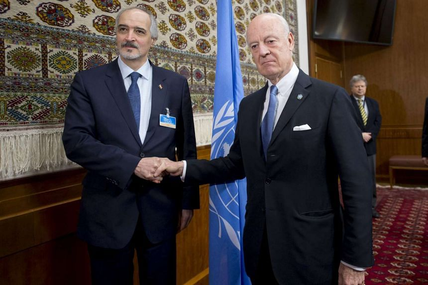 UN envoy Staffan de Mistura shaking hands with Syria's Ambassador to the UN Bashar al Jaafari (left) during the Syria peace talks on Jan 29, 2016.