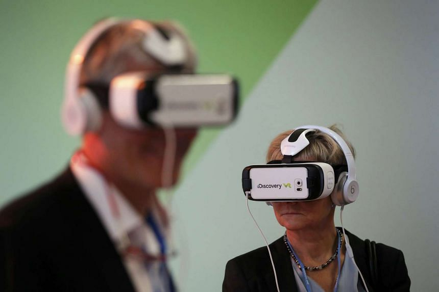 Participants wear virtual reality headsets during the World Climate Change Conference in 2015.
