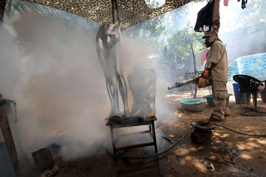 A worker fumigating the Plan 3000 District as a preventive measure against the Zika virus and other mosquito-borne diseases in Santa Cruz, Bolivia, on Jan 29, 2016.