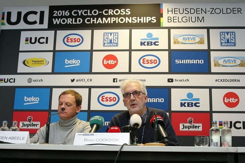 Union Cycliste Internationale (UCI) president Brian Cookson (right) speaks during a press conference at the UCI 2016 cyclo-cross World Championships in Heusden-Zolder, Belgium, on Jan 31, 2016.