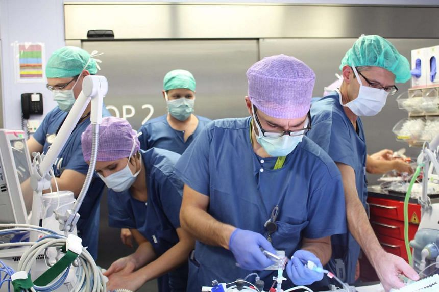 A handout picture provided by the Inselspital Bern hospital shows doctors and nurses during the surgery to separate conjoined twins Lydia and Maya in Bern on Dec 10, 2015.