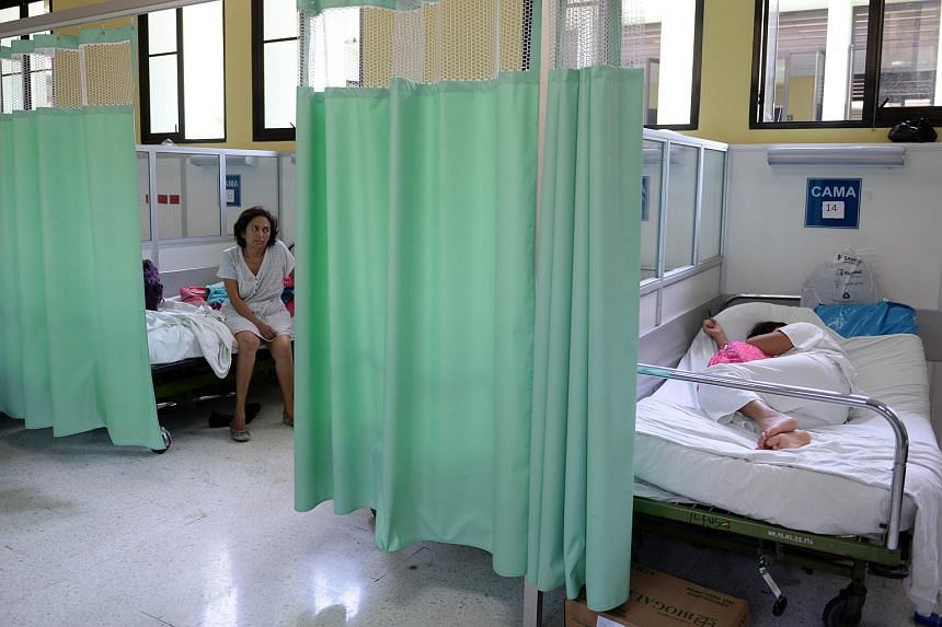 A patient recovering from the Guillain-Barre syndrome (left) at Rosales National Hospital in San Salvador, on Jan 27, 2016.