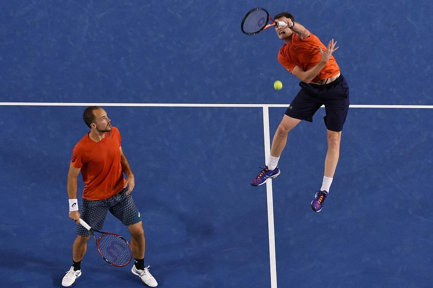 Britain's Jamie Murray (right) plays a shot past partner Brazil's Bruno Soares at the Australian Open, on Jan 30, 2016.