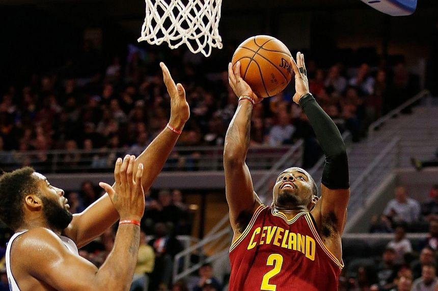 Cleveland's Kyrie Irving (right) getting to the basket past Detroit's Andre Drummond during the second half at The Palace. The Cavaliers beat the Pistons 114-106.