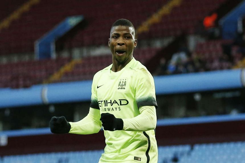 Kelechi Iheanacho celebrates scoring the third goal for Manchester City completing his hat-trick.