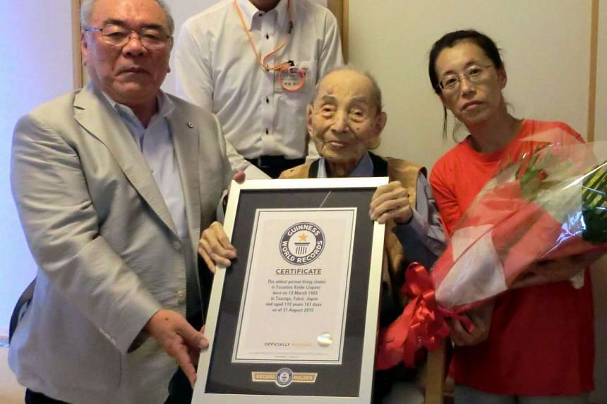 The late Japanese supercentenarian Yasutaro Koide (centre), who was claimed by the Guinness World Records as the oldest living man.