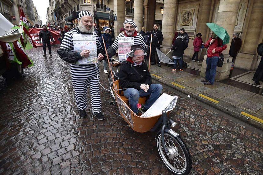 People dressed as convicts join others in the Paris state of emergency protests.