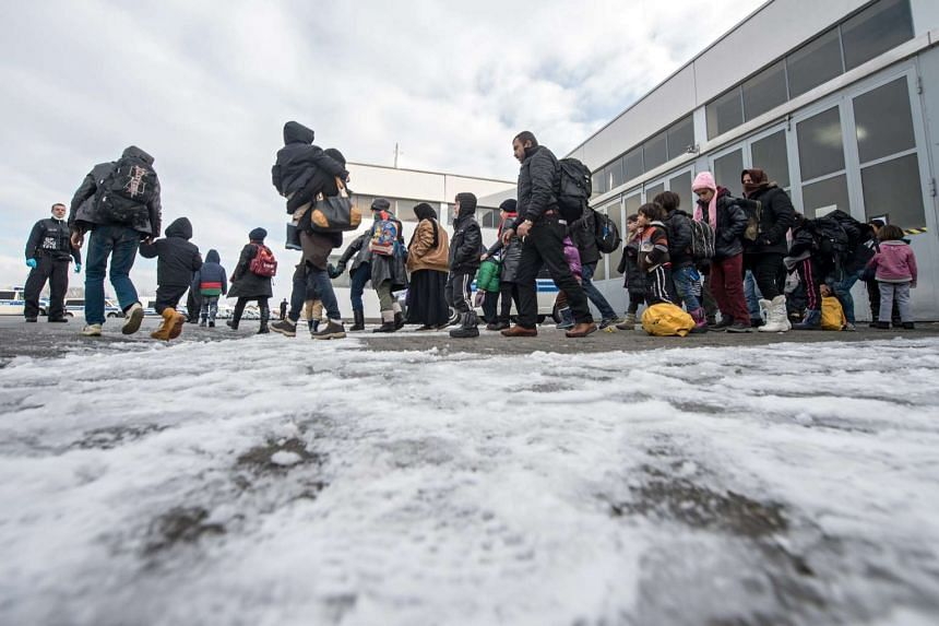 Refugees at a police clearing station in Passau, Germany, on Jan 16, 2016.