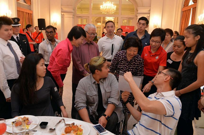 (Standing from left) Dr Teo-Koh, President Tony Tan, Mrs Mary Tan and Minister Grace Fu chat with para-swimmers (seated, from left) Yip Pin Xiu, Theresa Goh and James Leo at the Istana reception yesterday.