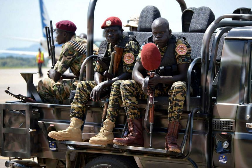 South Sudan's soldiers sitting on a truck at the airport in Juba.