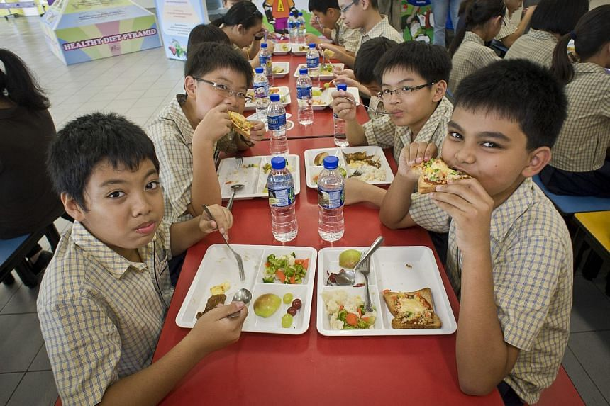 Wellington Primary School pupils enjoying healthy meals in the canteen.