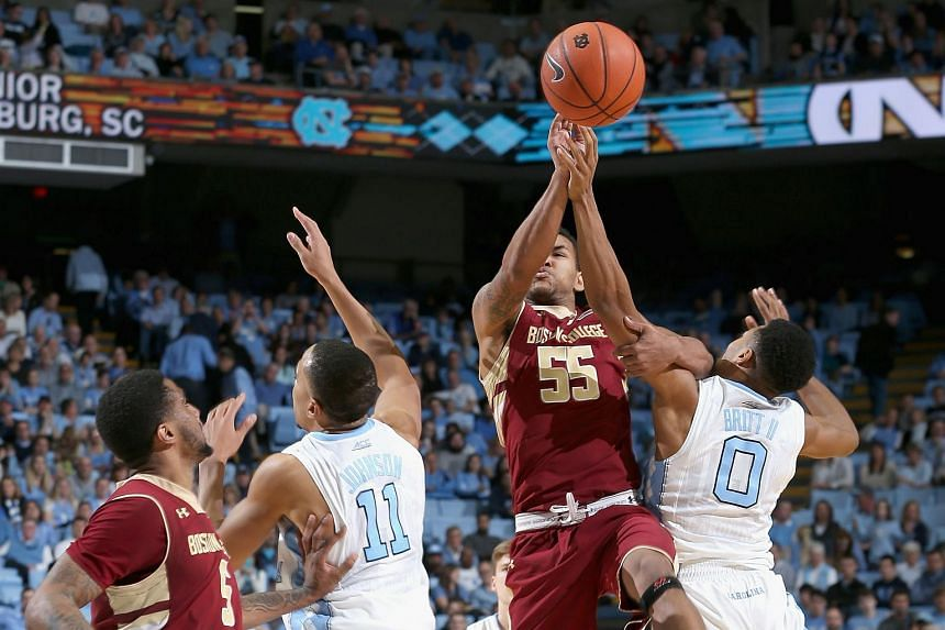 Sammy Barnes-Thompkins #55 of the Boston College Eagles battles for a loose ball with Nate Britt #0 of the North Carolina Tar Heels on Jan 30, 2016.