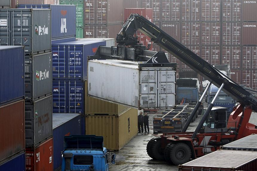Workers loading trucks with containers at a terminal of an Inland Container Depot in Uiwang, south of Seoul.