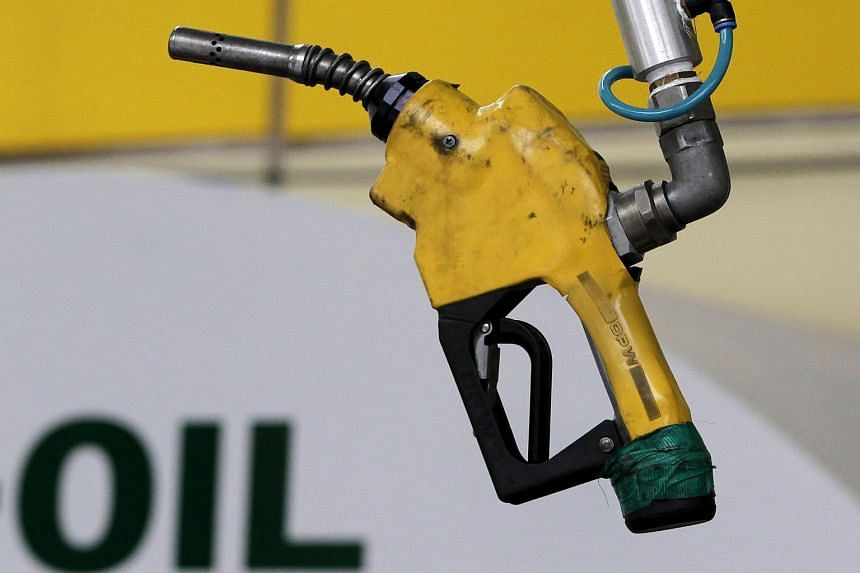 A gas pump is seen hanging from the ceiling at a petrol station in Seoul, South Korea.