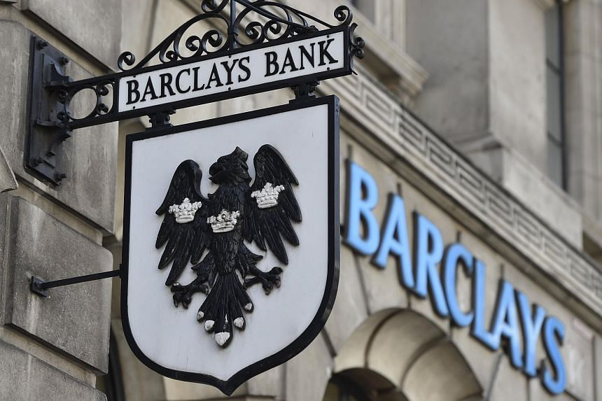 A Barclays sign hangs outside a branch of the bank in the City of London.
