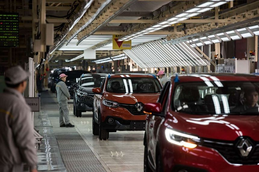 Chinese workers standing on the production line for Kadjar cars at a factory in Wuhan, Hubei province, on Feb 1, 2016.